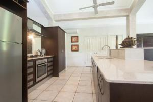 A kitchen or kitchenette at Tranquility By The Course Port Douglas