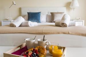 Letto o letti in una camera di HQ Rooms Apartments San Vicente