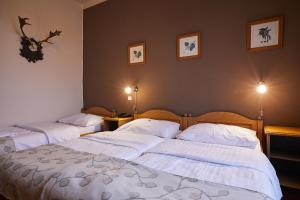 A bed or beds in a room at Hotel Panská