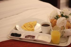 Opções de café da manhã disponíveis para hóspedes em Unique Suites