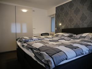 A bed or beds in a room at Ferienwohnung Horbach
