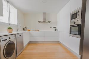 Cucina o angolo cottura di HQ Rooms Apartments San Vicente