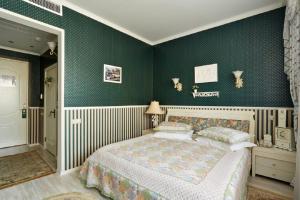 Кровать или кровати в номере Green House Hotel Tyumen