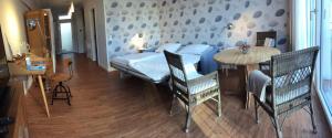 Ein Bett oder Betten in einem Zimmer der Unterkunft Port Sea Shell