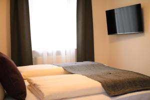 A bed or beds in a room at Boutique Hotel Beckenlehner