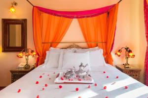 A bed or beds in a room at Nikos Takis Fashion Boutique Hotel