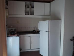 Una cocina o zona de cocina en Hotel Jardines de Dayman