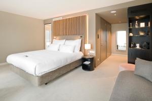 Ein Bett oder Betten in einem Zimmer der Unterkunft Pestana Amsterdam Riverside