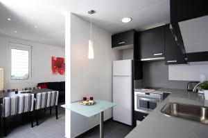 Una cocina o zona de cocina en Sant Pau Apartments