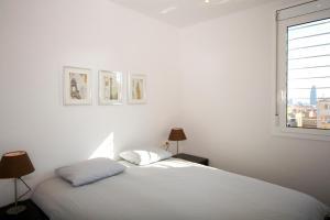 Cama o camas de una habitación en Sant Pau Apartments