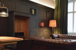 Ein Sitzbereich in der Unterkunft Linnen Luxx Apartment