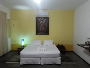 Cama ou camas em um quarto em Anjo Azul Pousada