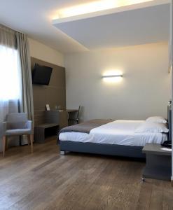 Кровать или кровати в номере Hotel Di Varese
