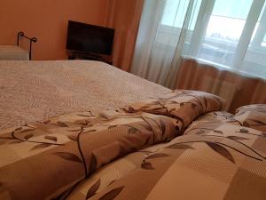 Кровать или кровати в номере Ratslinden Apartment
