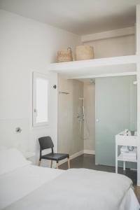 A bed or beds in a room at Tramuntana Hotel - Adults Only