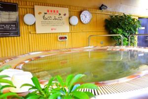 The swimming pool at or near Sauna & Capsule Hotel Rumor Plaza
