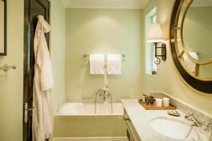 A bathroom at Royal Livingstone Hotel by Anantara