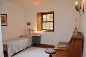 Uma cama ou camas num quarto em Casa do Silvério