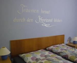 Ein Bett oder Betten in einem Zimmer der Unterkunft Fewo Reinsch Goslar-Hahnenklee