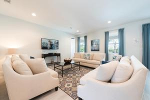 A seating area at Splendid Home with Loft Area & Private Pool near Disney - 7619B