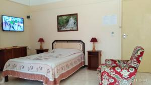 A bed or beds in a room at Alpha Villa