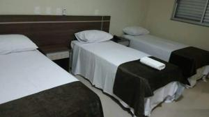 A bed or beds in a room at Apoema Hotel