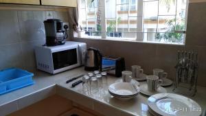 A kitchen or kitchenette at Alpha Villa
