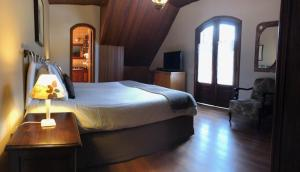 A bed or beds in a room at Pousada Via Campos