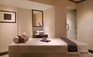 A bed or beds in a room at Hyatt Regency Kinabalu
