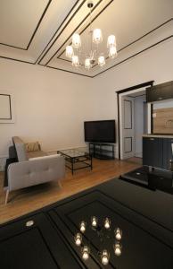 Télévision ou salle de divertissement dans l'établissement Appartement Le roi
