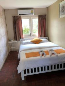 A bed or beds in a room at VX The Fifty