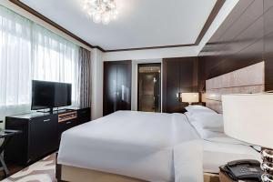 A bed or beds in a room at Hyatt Regency Kiev