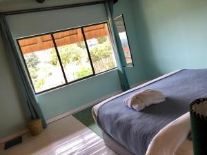 Een bed of bedden in een kamer bij Pili Pili Boutique Hotel