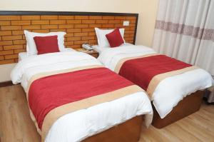 A bed or beds in a room at Hotel Bagmati