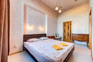 Кровать или кровати в номере СТН на Караванной
