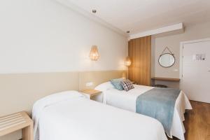 Cama o camas de una habitación en Hotel Catalunya Ribes de Freser