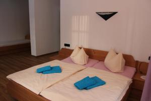 A bed or beds in a room at Hotel Waldhaus