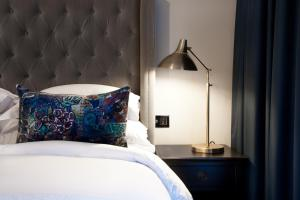 A bed or beds in a room at Sand Hotel by Keahotels