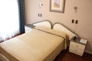 Cama ou camas em um quarto em Ayacucho Palace Hotel