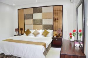 Cama ou camas em um quarto em Maqam AL Diyafa