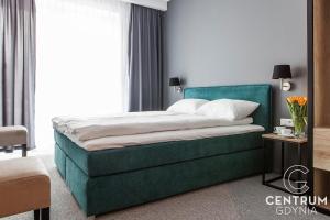 Łóżko lub łóżka w pokoju w obiekcie Gdynia Centrum