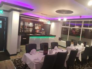 A restaurant or other place to eat at Ascot Grange Hotel - Voujon Resturant