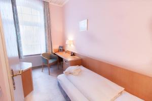 Ein Bett oder Betten in einem Zimmer der Unterkunft Nordseehotel Freese