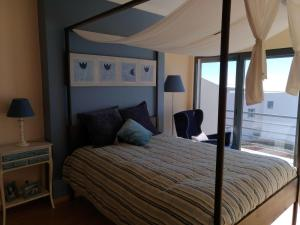 A bed or beds in a room at Terraços da Peralta - Moradia D