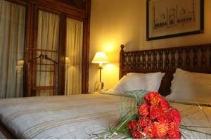 A bed or beds in a room at Portemilio Hotel & Resort