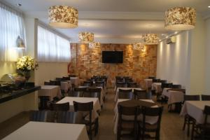 A restaurant or other place to eat at Candango Aero Hotel