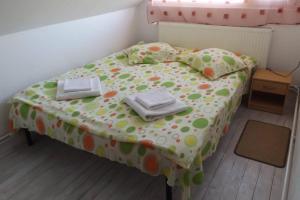 Un pat sau paturi într-o cameră la Casa Daya
