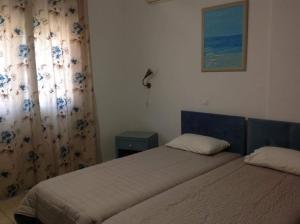 Een bed of bedden in een kamer bij Studios Ageri