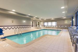 The swimming pool at or near SpringHill Suites Grand Rapids North