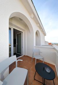 A balcony or terrace at Hotel Mediteran